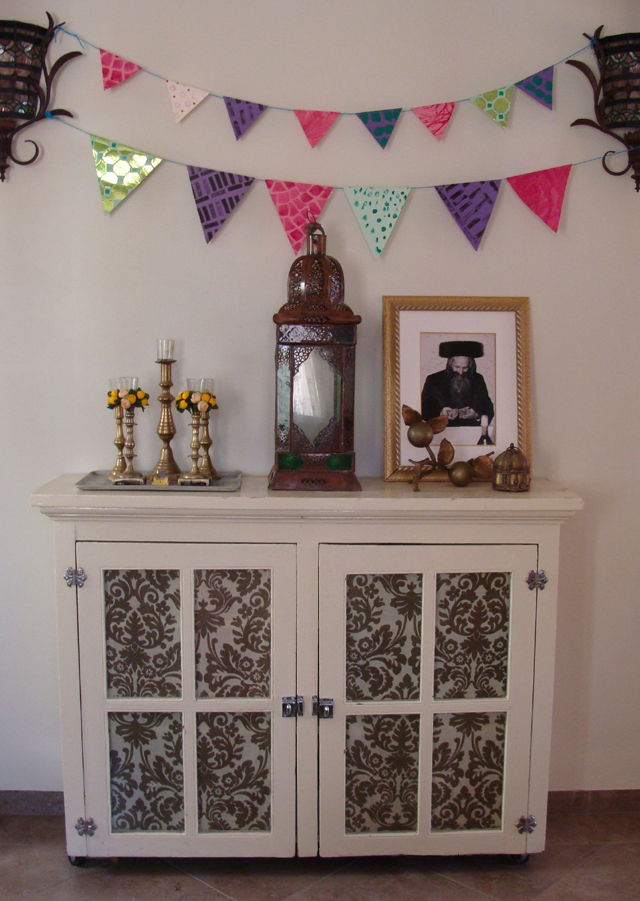 Paper Bunting Banner Over Cabinet