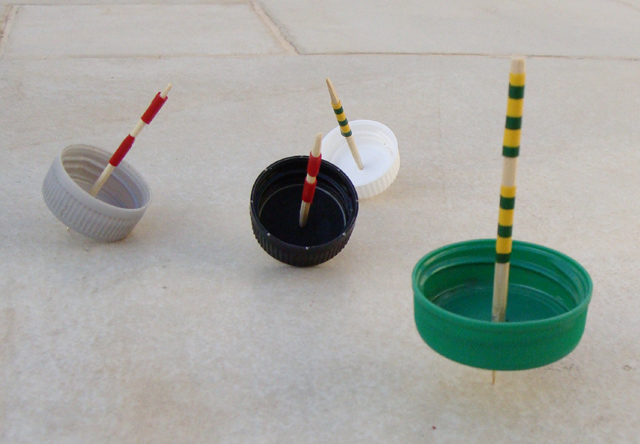 A Handmade Hanukkah Game Spinning Tops From Plastic Bottle Caps