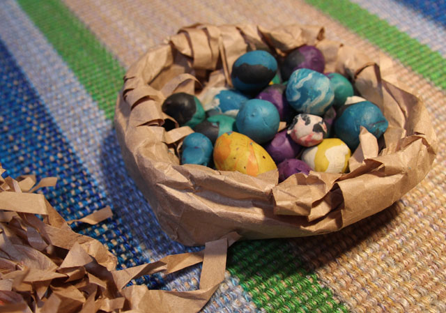 Paper Bag Nest Filled With Modeling Clay Eggs