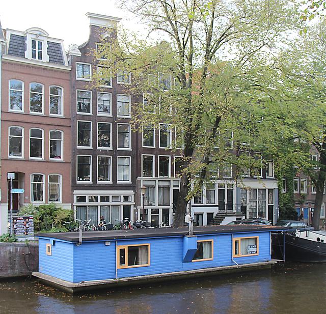 Dutch cute blue canal houseboat