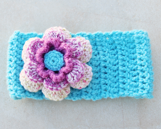 Crocheted ear warmer with flower