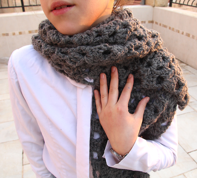 Crocheted chunky lacy scarf on child