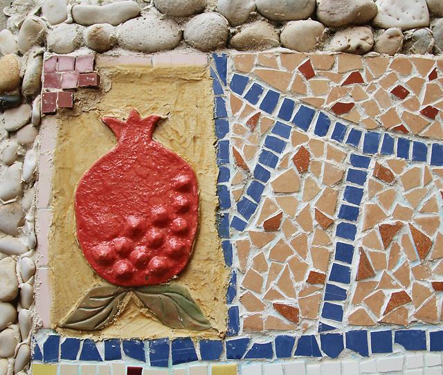 Garden mosaic with pomegranite