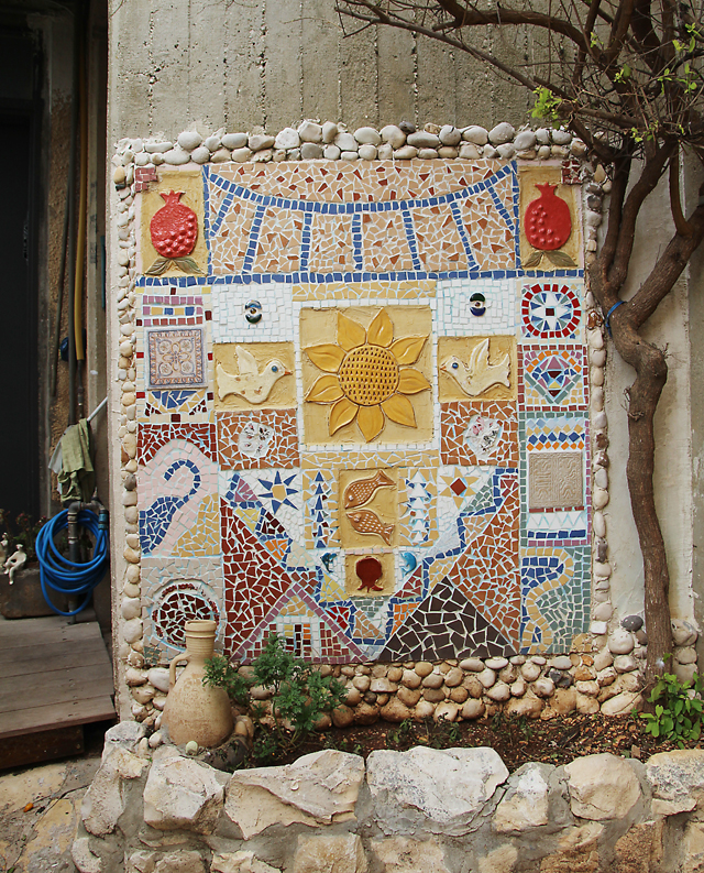 Garden mosaic with ceramics and tiles