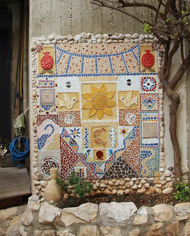 Garden mosaic with ceramics and tiles