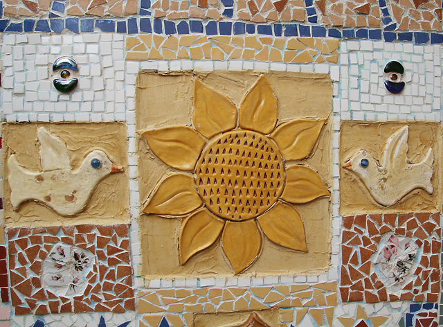 Garden mosaic with sun and birds
