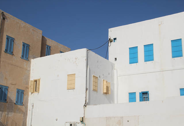 Akko white buildings with blue shutters