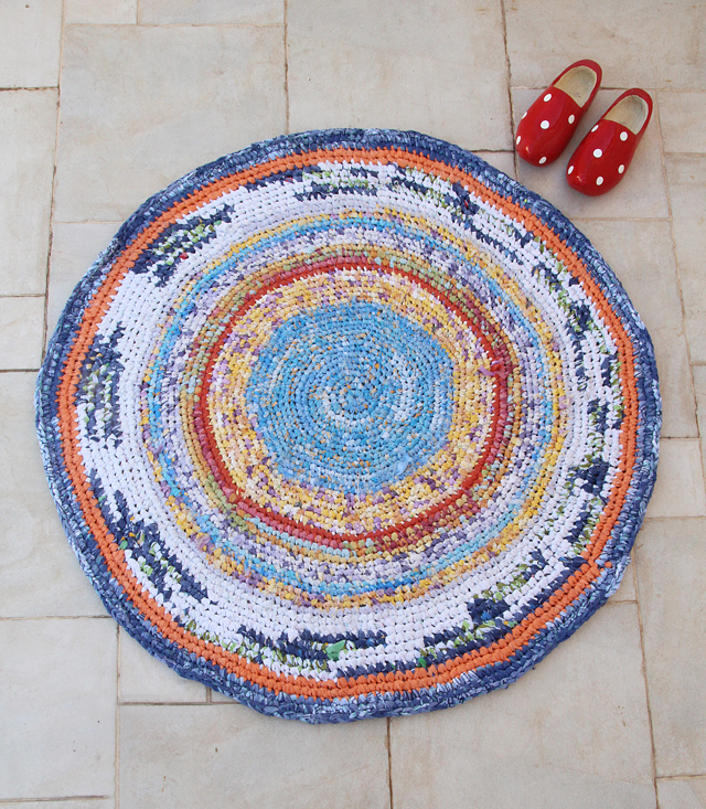 Crocheted Rag Rug With sheets Blues and oranges