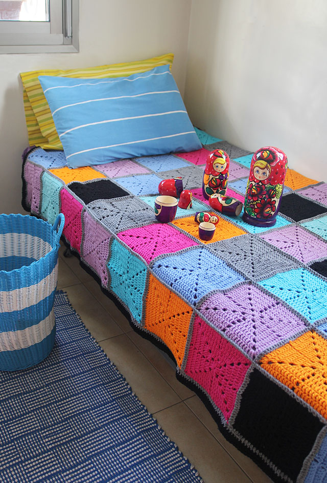 Crocheted Starburst Patchwork blanket on bed