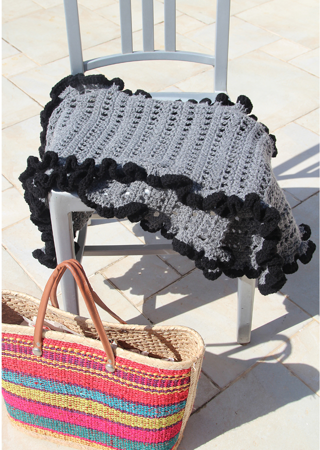 Crocheted ruffled edge shawl