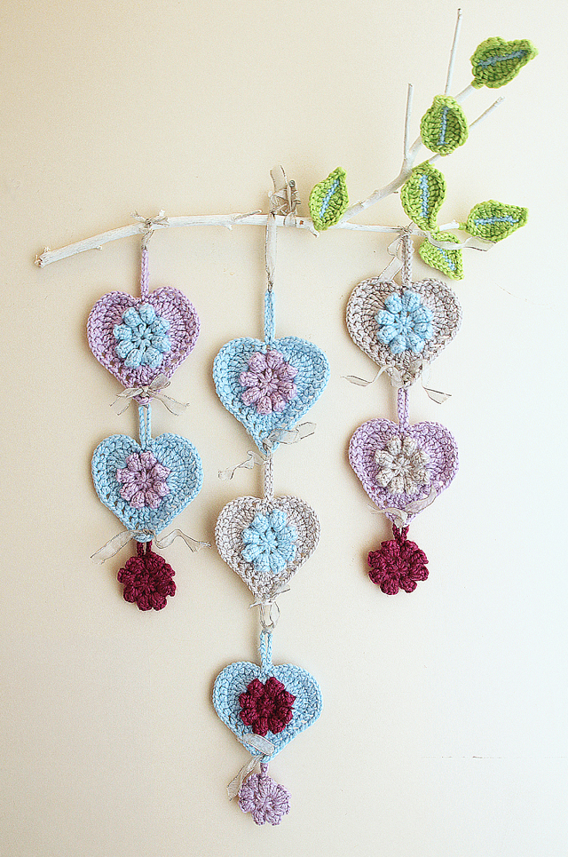 crocheted hearts wall hanging on branch