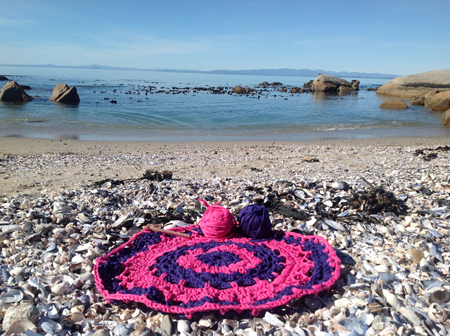 Giant Crocheted Doily Rug in progress by the sea