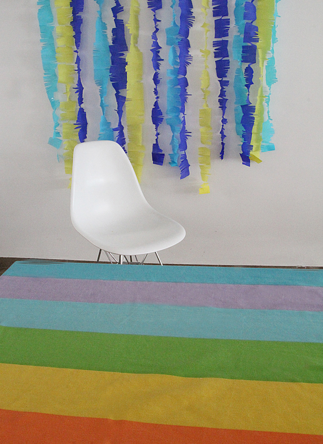 Crepe Paper Streamers With Rainbow Tablecloth