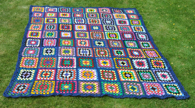 Crocheted Granny Square Blanket on grass