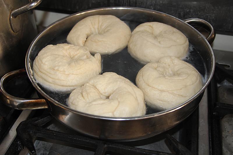 Bagels boiling before baking