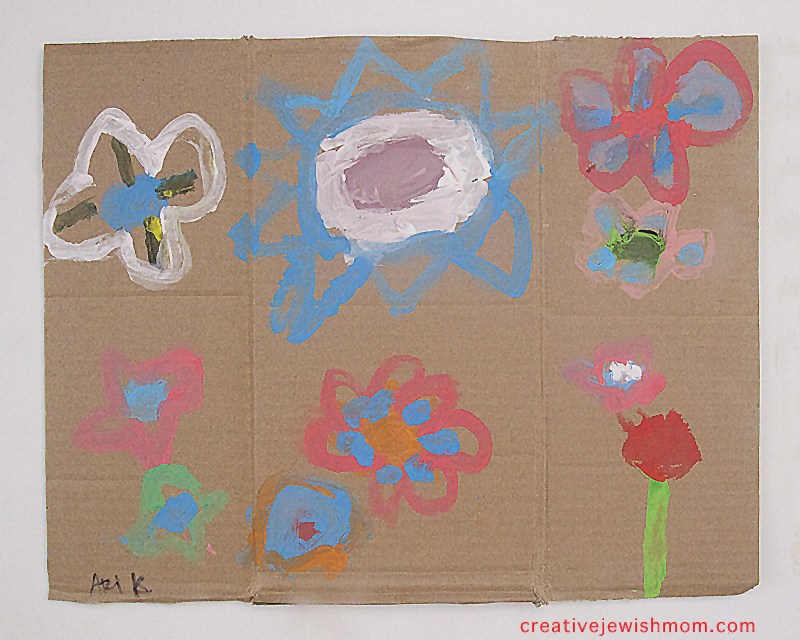 Flower paintings on cardboard scraps