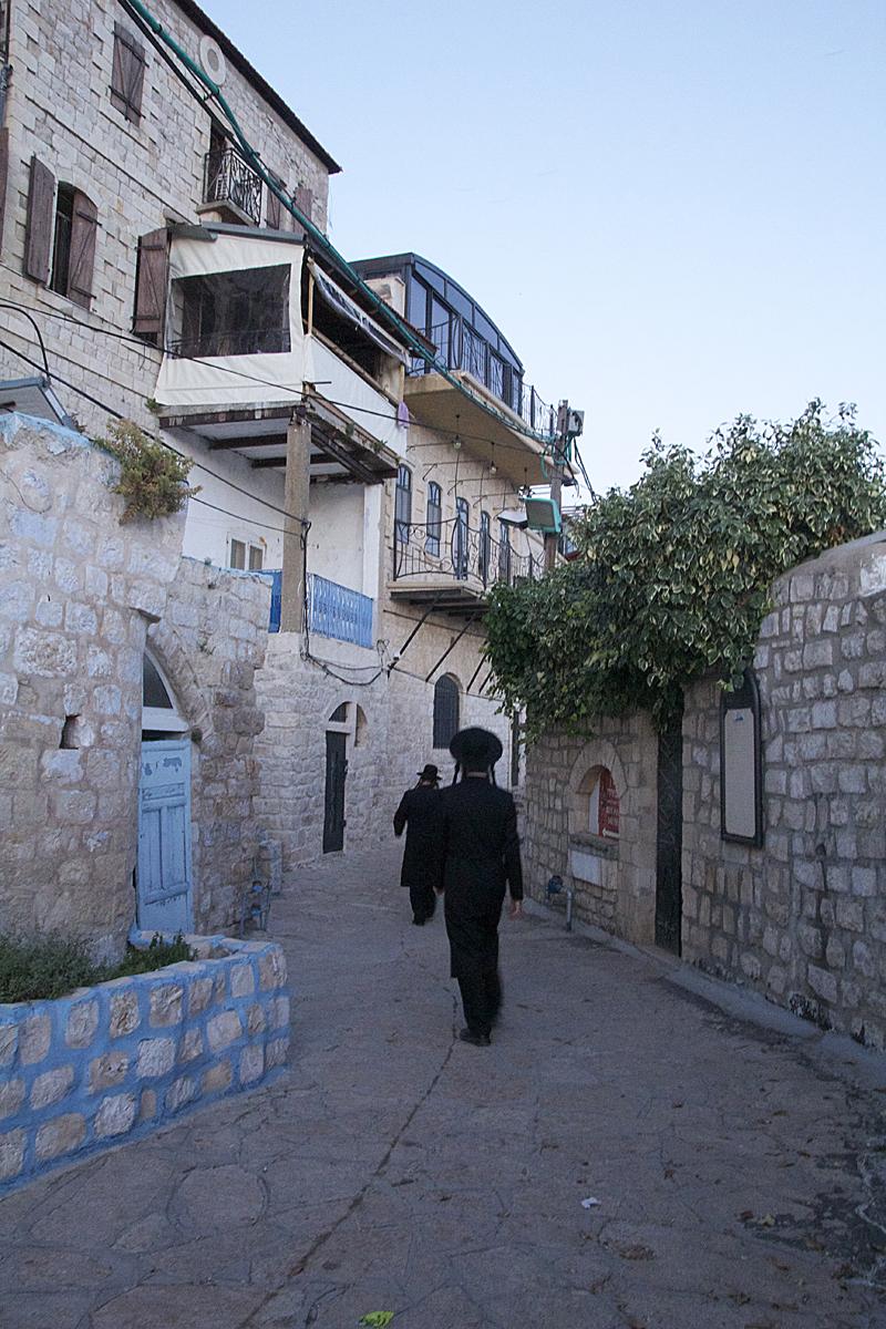 Blue door in cobblestone alley old city safed