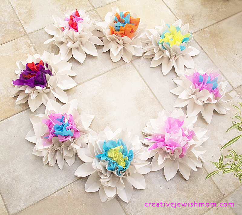 Newsprint and Crepe paper flowers in a circle