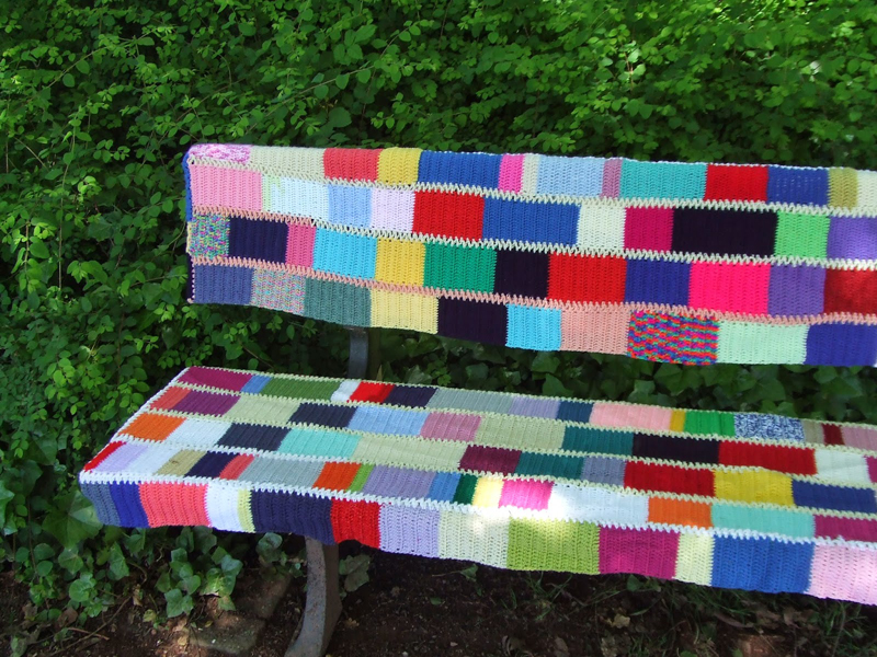 Crocheted park bench cover