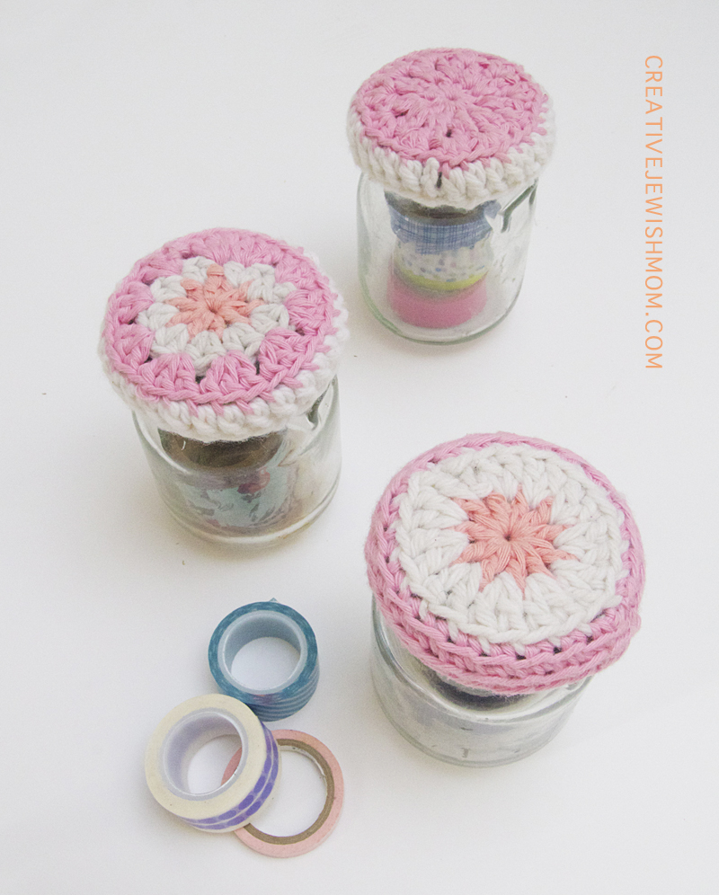 Crocheted jar toppers, in a row
