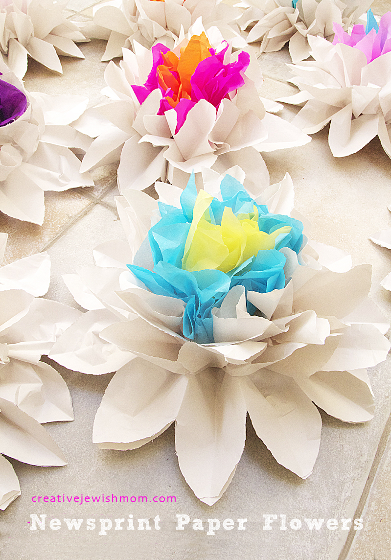 Newsprint and crepe paper accordian flower centerpieces