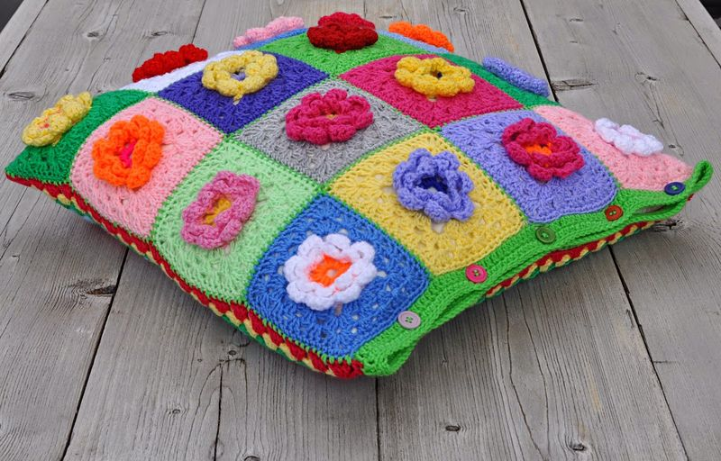 Crocheted granny raised flower pillow