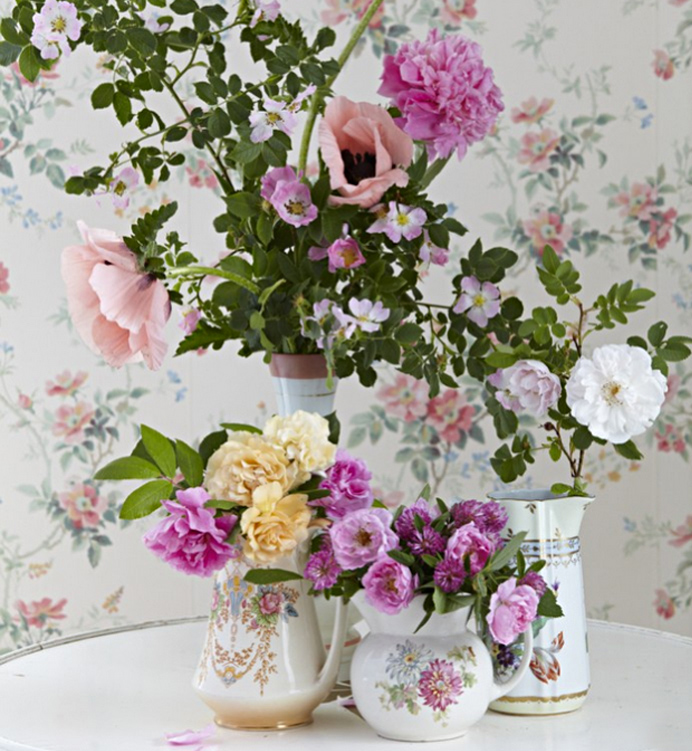 Decorating with flowers vintage containers