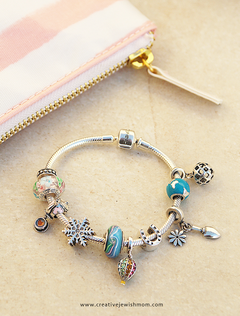 Charm bracelet with striped bag