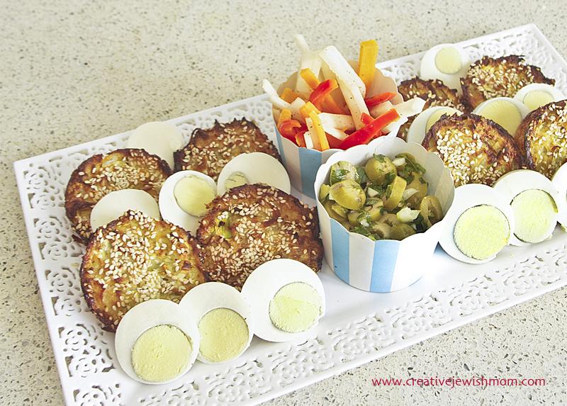 Mini Kugel Platter With Sliced Eggs And Olive Salad
