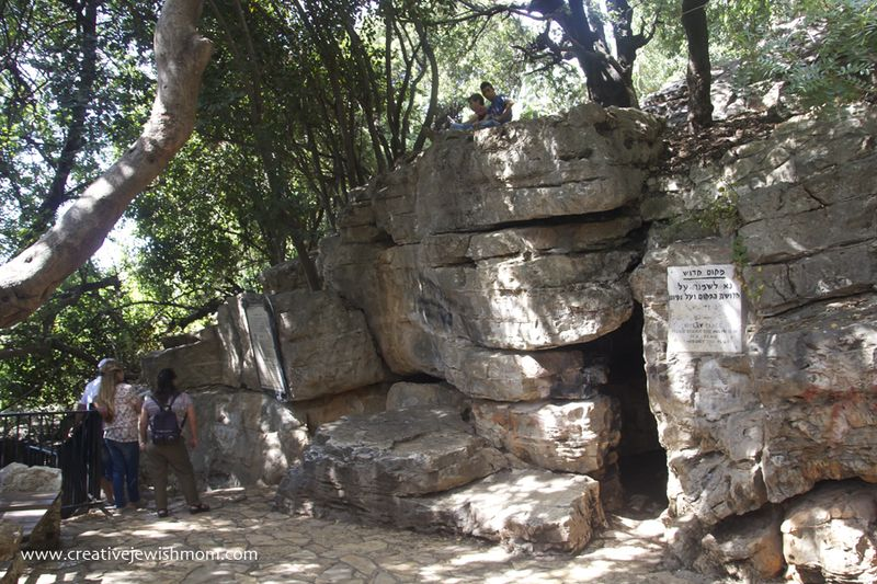 Cave Of Rebbi Shimon Pekiin with tourists