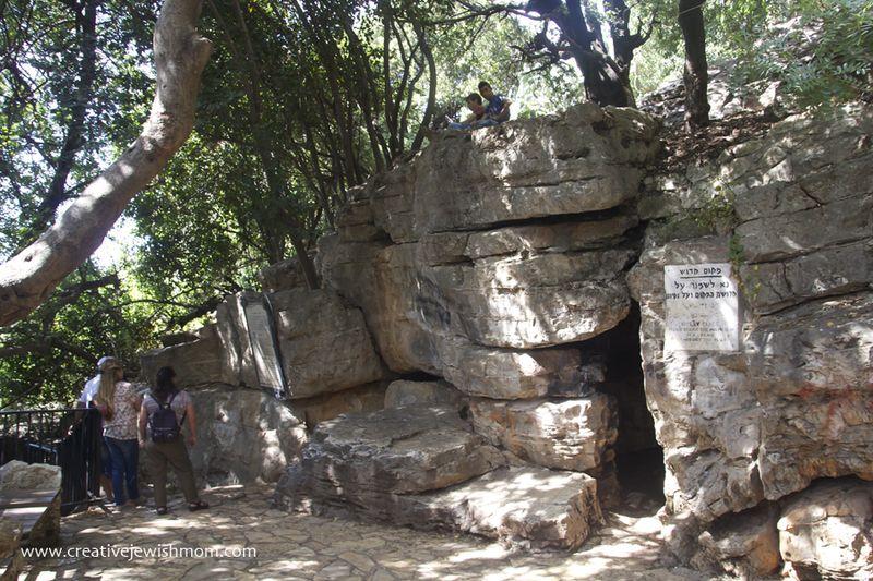 Cave Of Rebbi Shimon Pekiin with tourists