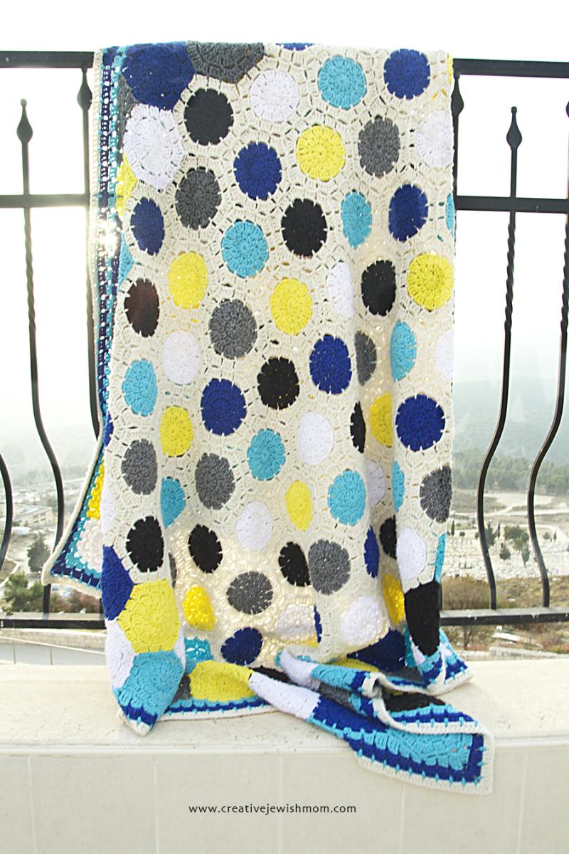 Crocheted Granny Hexigon Blanket On Railing