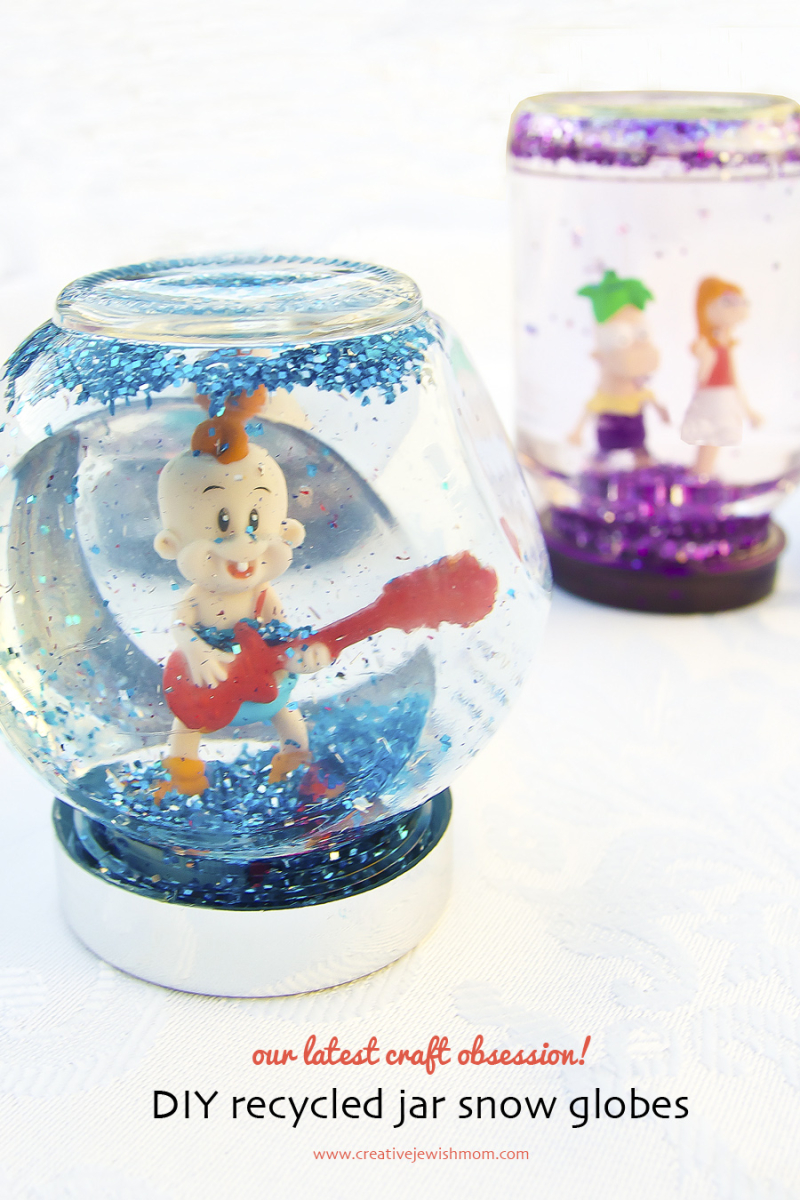 DIY recycled jar snow globe with blue glitter