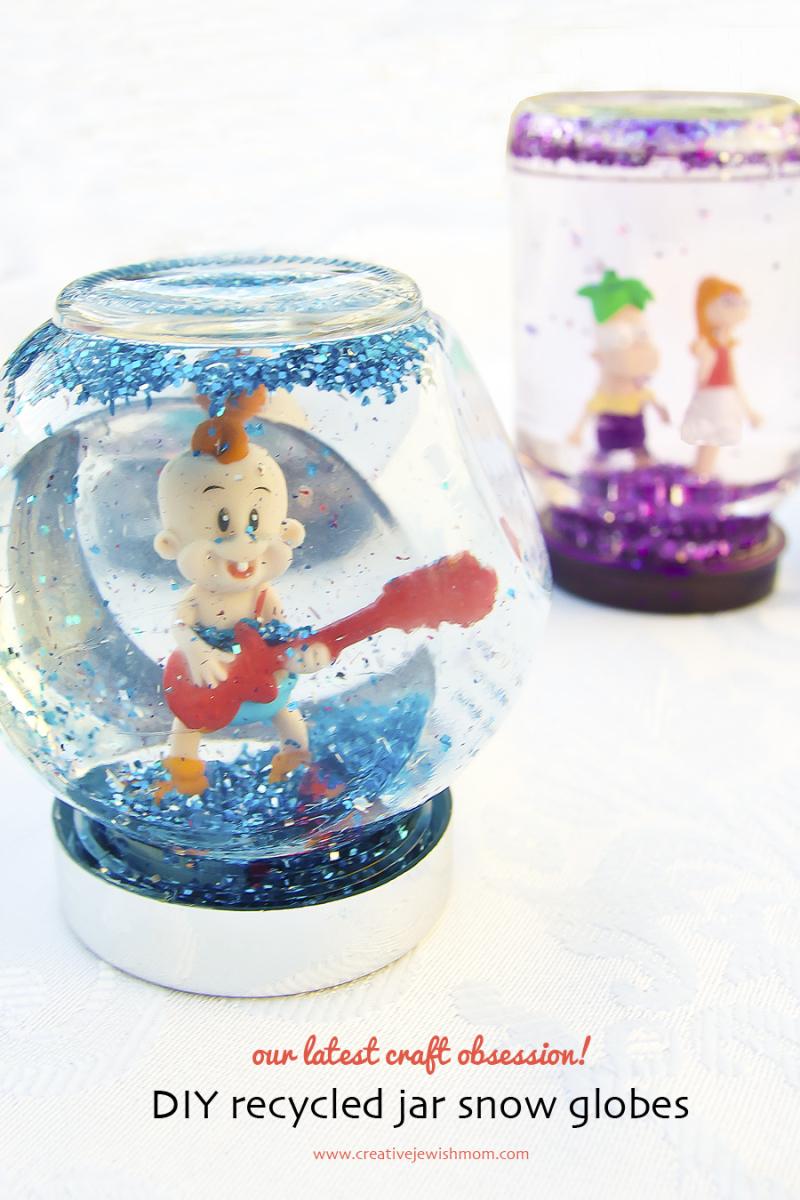 DIY recycled jar snow globe with blue glitter