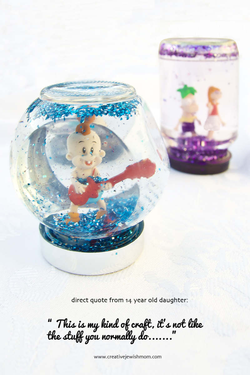 DIY recycled jar snow globe with plastic figures