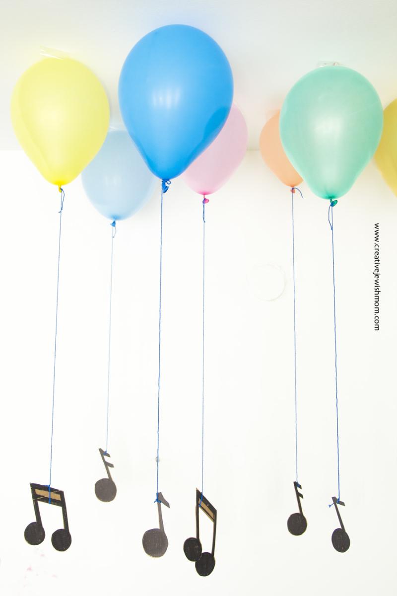 Musical notes party decor with faux helium balloons