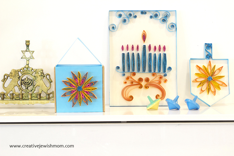 Quilled Hanukkah crafts with brass menorah