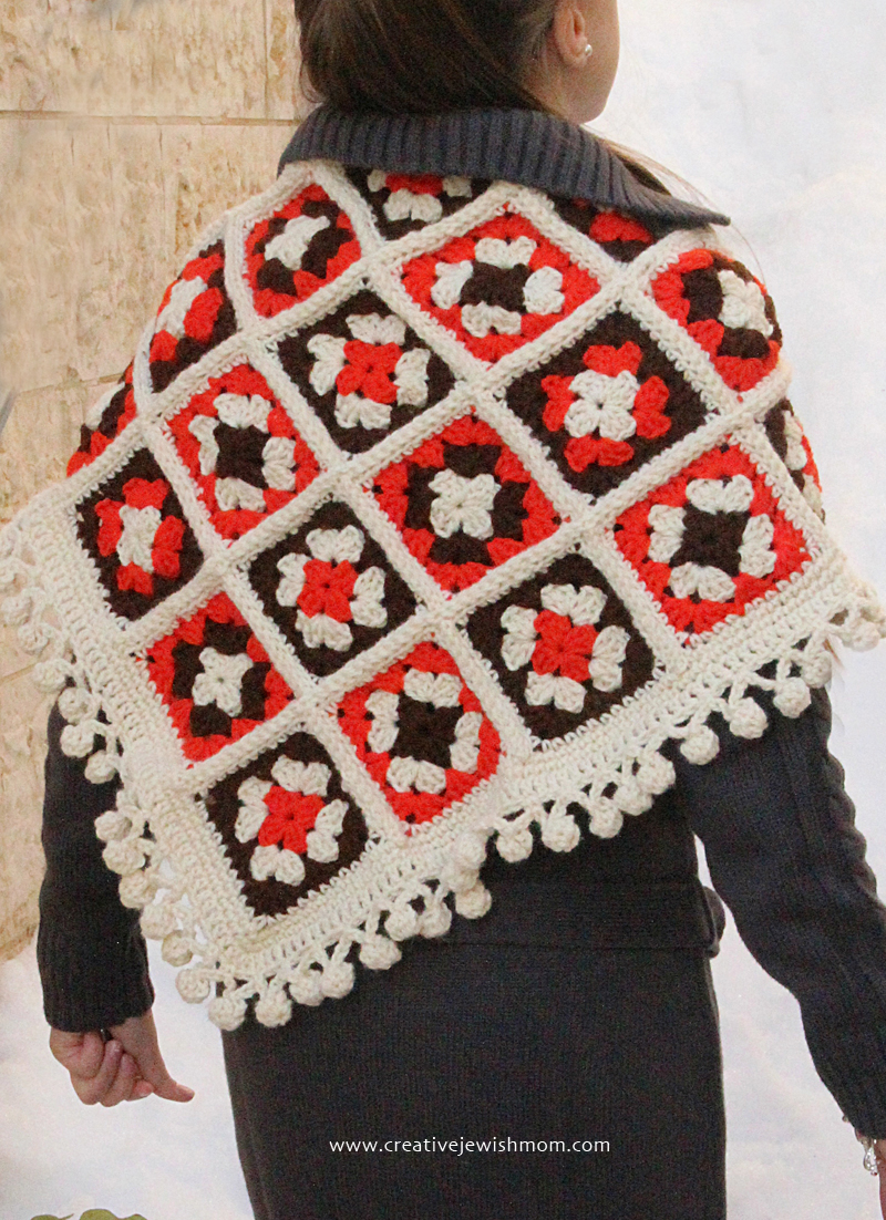 Crocheted Granny Square Shawl with pom pom trim