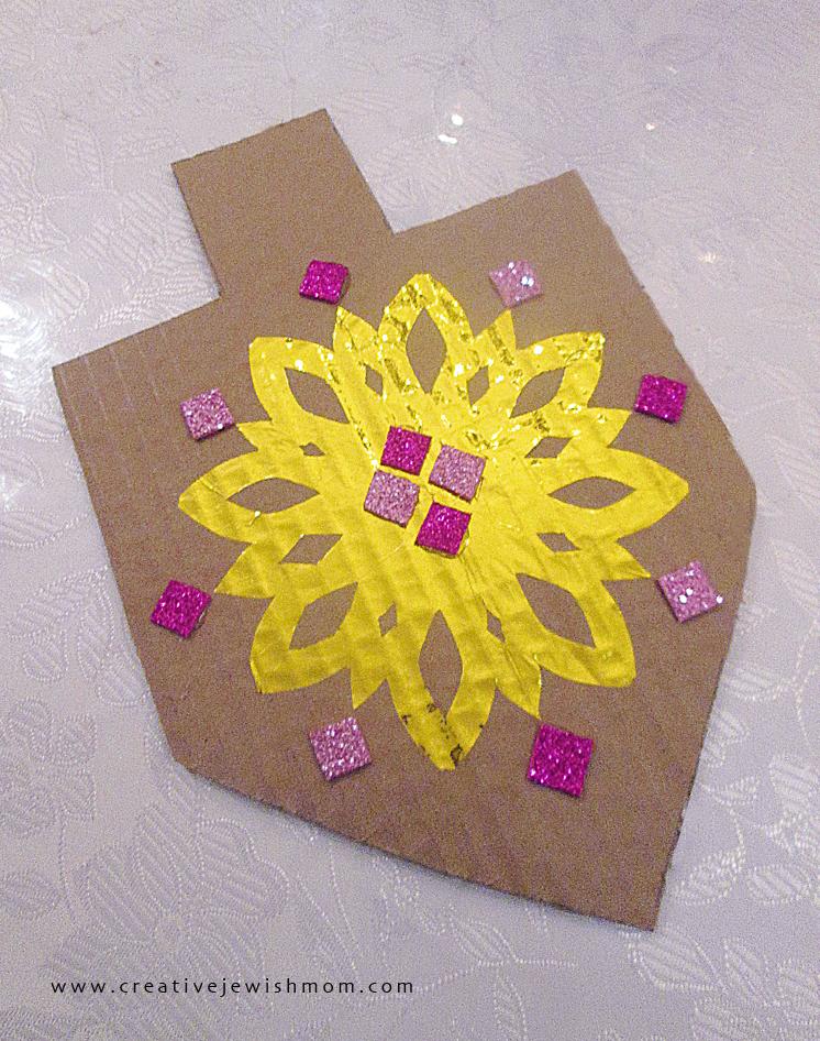 Hanukkah dreidel craft from cardboard