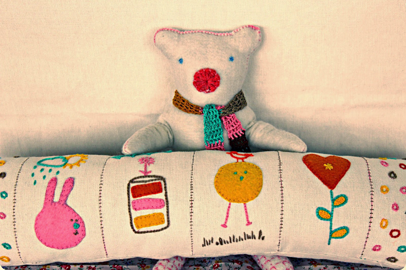 Embroidered neck pillow and bear