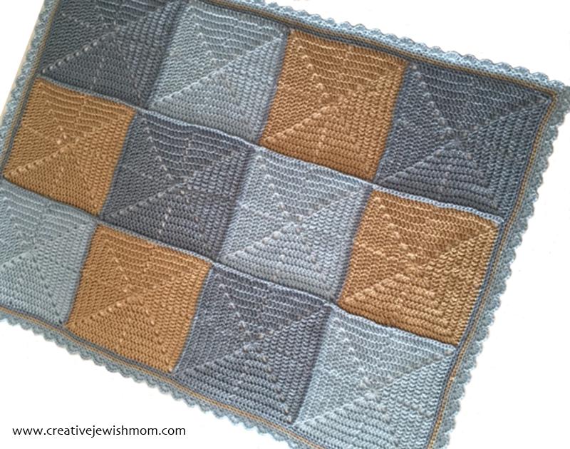 Crochet Starburst Baby Blanket blues and greys silhouette