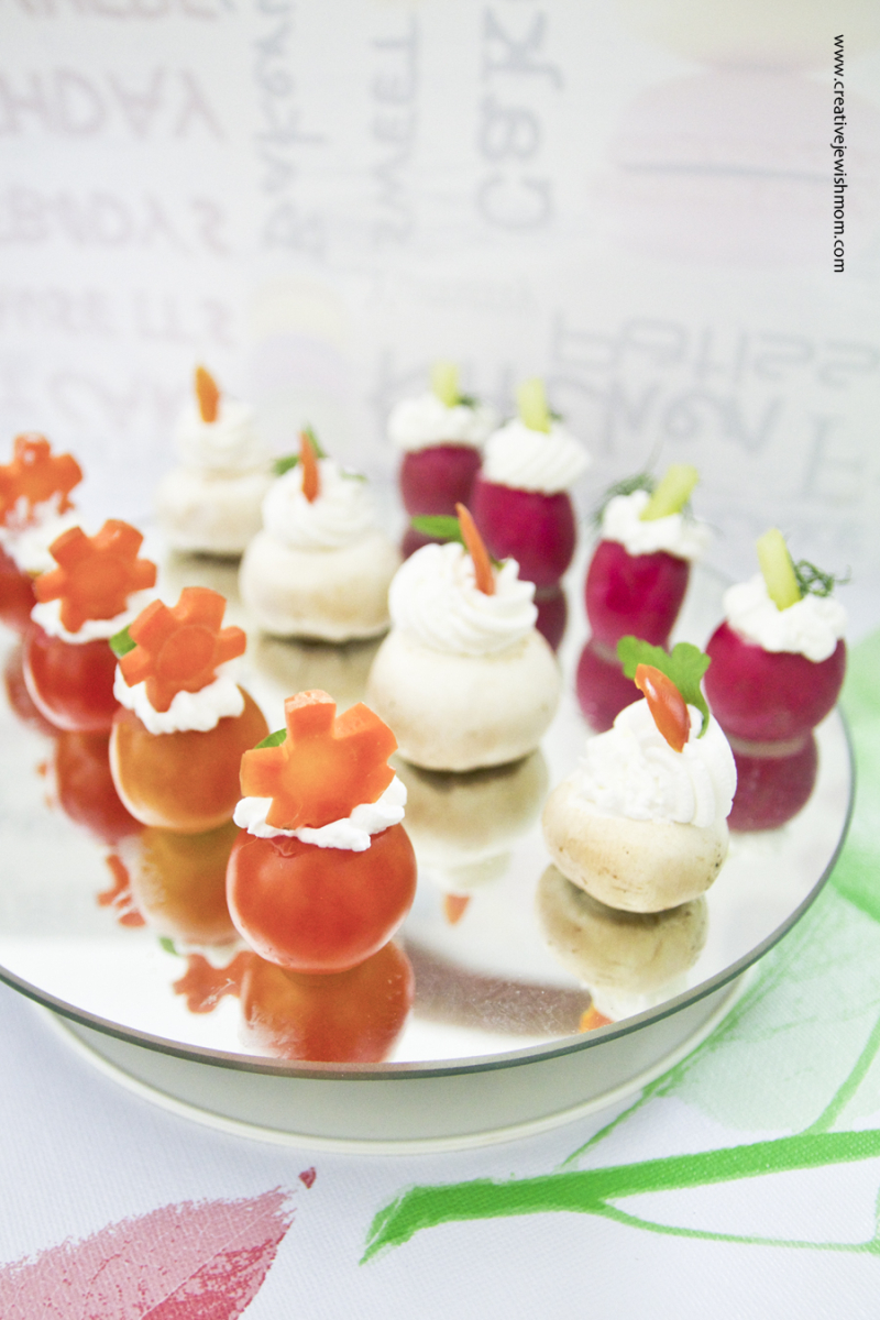 Vegetables with cream cheese on mirror