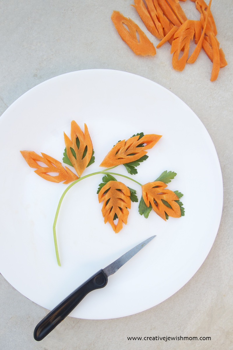 Vegetable carving carved carrot leaves with carving knife