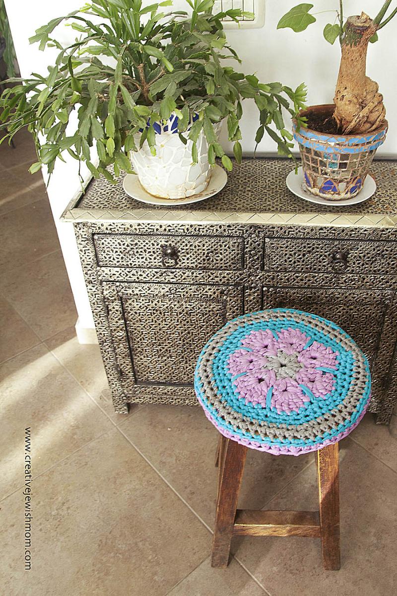 Crocheted t-shirt yarn flower stool cover