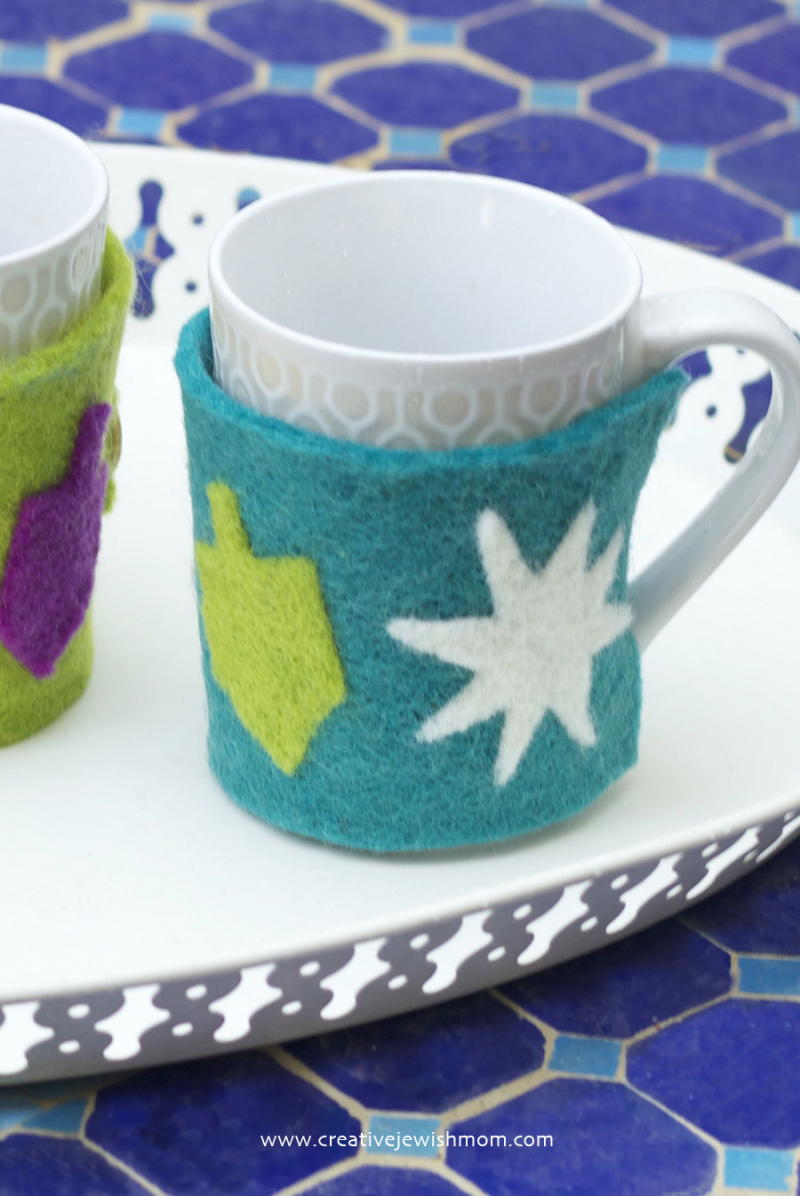 Hanukkah Felted Mug Cozies on moroccan tile