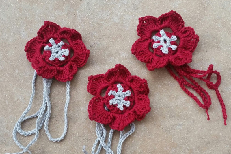 Crocheted red poppy napkin rings