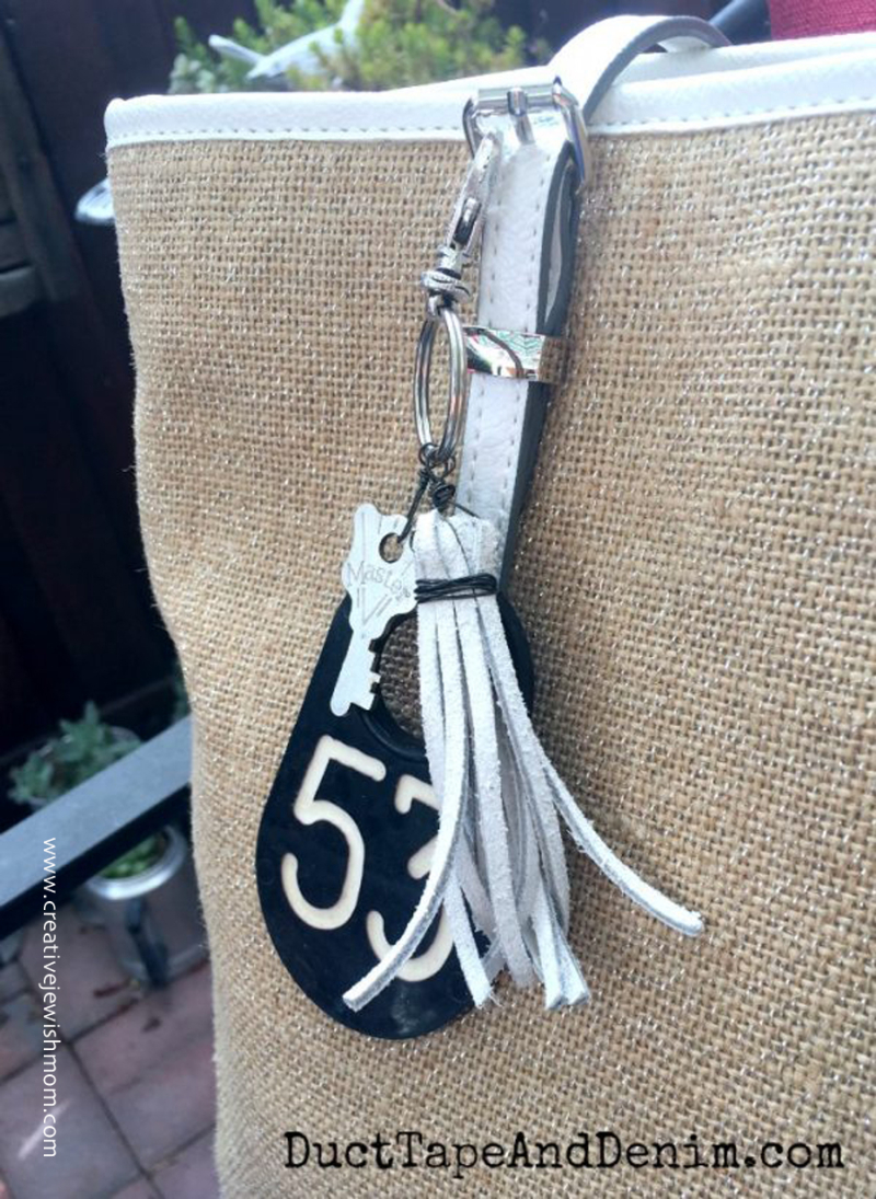 DIY-purse-charm-with-old-cow-ear-tag-leather-tassel-and-key
