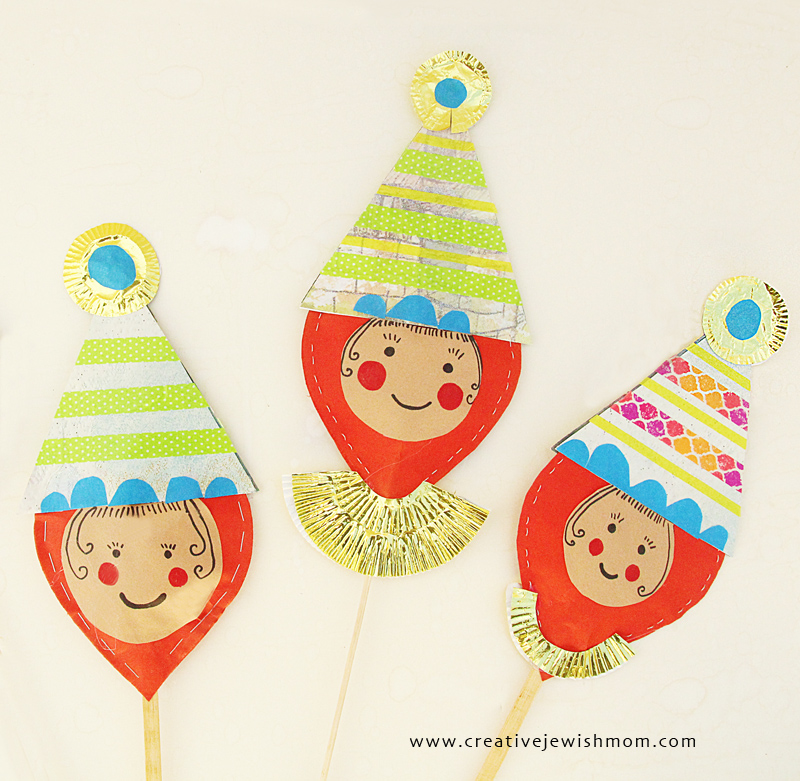 Paper clowns on a stick