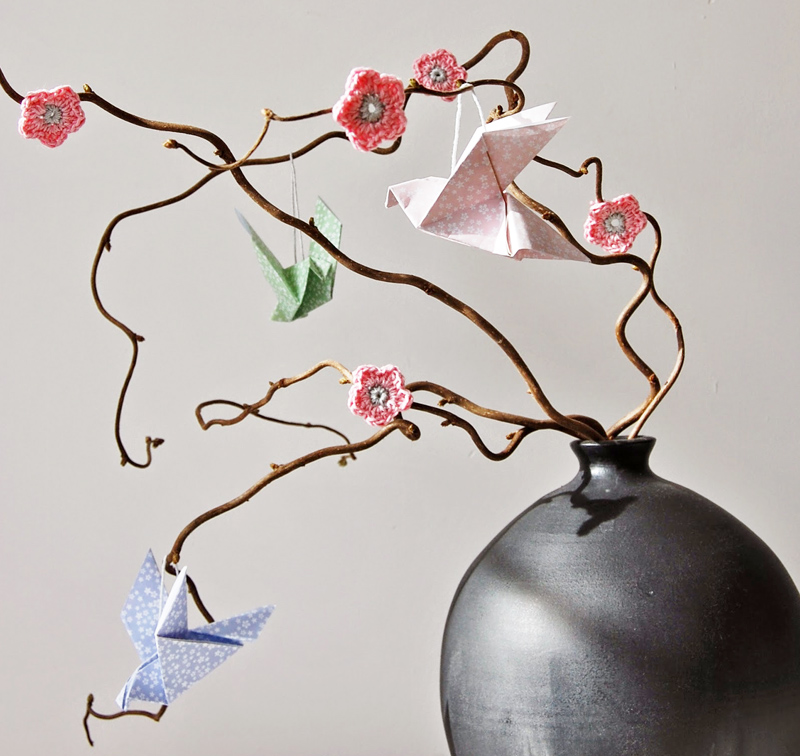 Crocheted cherry blossoms with origami birds