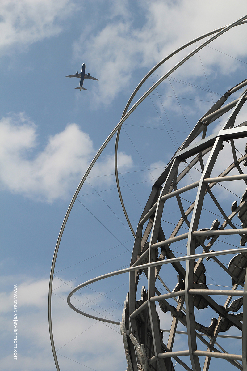 Unisphere In Flushing close up with plane